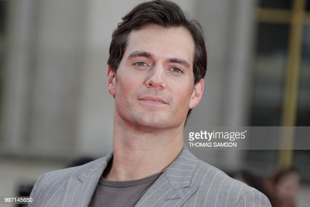 British actor Henry Cavill poses on the red carpet as he arrives to attend the world premiere of his new film Mission: Impossible Fallout, on July...