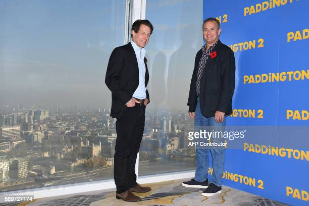 British actor, Hugh Bonneville and English actor, Hugh Grant pose during a photocall for the film, Paddington 2, in southeast London on November 3,...