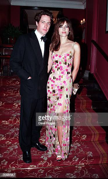 """British actor Hugh Grant and girlfriend Elizabeth Hurley attend the film premiere of """"Mickey Blue Eyes"""" in Leicester Square, London on August 14,..."""