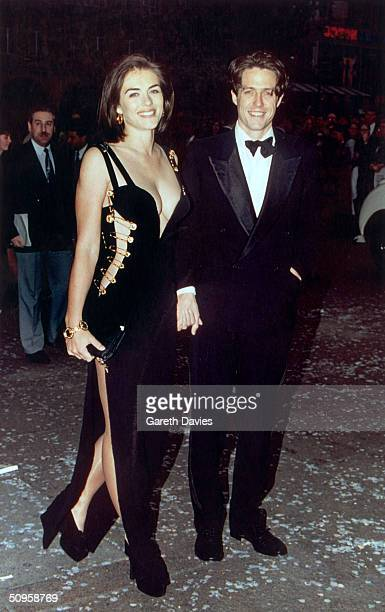 British actor Hugh Grant and his girlfriend Elizabeth Hurley attend the premiere of Grant's latest film, 'Four Weddings and a Funeral' in London,...