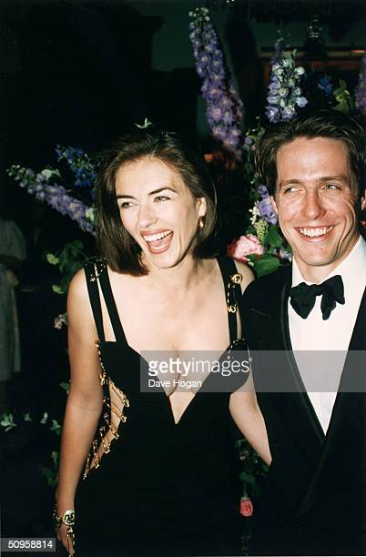 British actor Hugh Grant and his girlfriend Elizabeth Hurley attend the post-premiere party of Grant's latest film, 'Four Weddings and a Funeral' in...