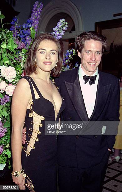 "British actor Hugh Grant and his girlfriend Elizabeth Hurley attend the post-premiere party for ""Four Weddings And A Funeral"" on May 11, 1994 in..."