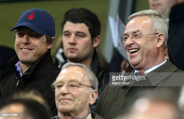 British actor Hugh Grant and Martin Winterkorn CEO of Volkswagen seen during the UEFA Europa League quarter final second leg match between VfL...