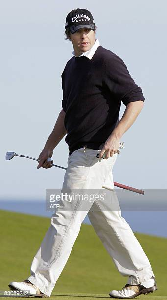 British actor Hugh Grant plays on the first day of the Alfred Dunhill Links Golf Championship in St Andrews Scotland on October 2 2008 AFP Photo/Ed...