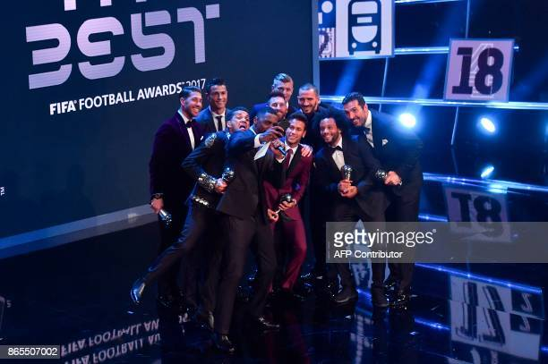 TOPSHOT British actor Idris Elba acting as host poses for a selfie photograph with Real Madrid and Portugal forward Cristiano Ronaldo Barcelona and...