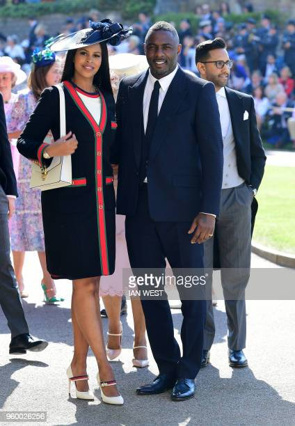 British actor Idris Elba and Sabrina Dhowre arrive for the wedding ceremony of Britain's Prince Harry Duke of Sussex and US actress Meghan Markle at...