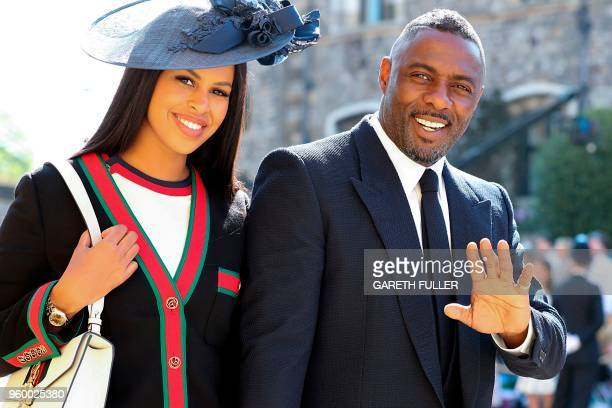 British actor Idris Elba arrives with his fiancee Sabrina Dhowre for the wedding ceremony of Britain's Prince Harry Duke of Sussex and US actress...