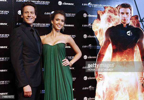 British actor Ioan Grudffudd and American actress Jessica Alba, pose next to a poster of the character Johnny Storm, aka The Human Torch, played by...