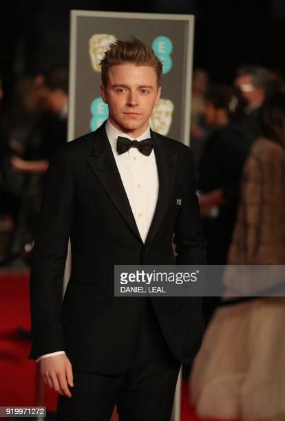 British actor Jack Lowden poses on the red carpet upon arrival at the BAFTA British Academy Film Awards at the Royal Albert Hall in London on...