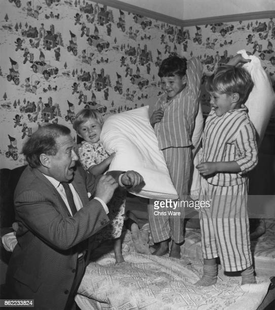 British actor James Hayter intervenes in a pillow fight between his children Judy Jonathan and Jeremy at their home in Hemel Hempstead UK October...