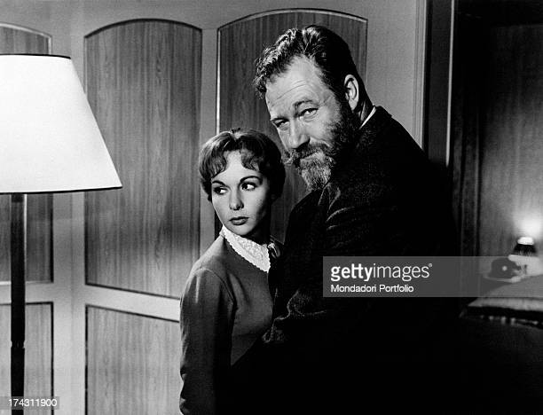 British actor James Robertson Justice hugging French actress FranÁoise Arnoul FranÁoise Annette Marie Mathilde Gautsch in Thèrèse Etienne 1958