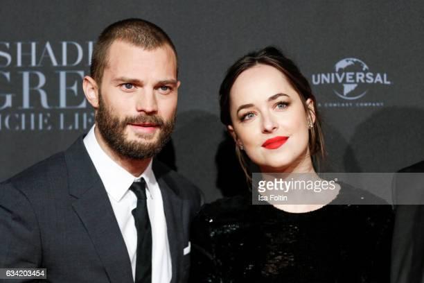 British actor Jamie Dornan and US actress Dakota Johnson attend the European premiere of 'Fifty Shades Darker' at Cinemaxx on February 7 2017 in...