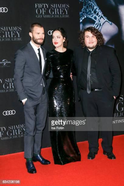 British actor Jamie Dornan US actress Dakota Johnson and youtube star Peter Hofmann attend the European premiere of 'Fifty Shades Darker' at Cinemaxx...