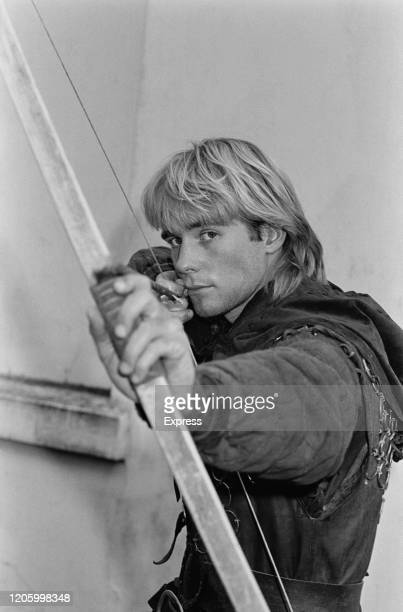 British actor Jason Connery poses with a bow and arrow as Robert of Huntingdon in HTV drama 'Robin of Sherwood' United Kingdom 15th April 1985