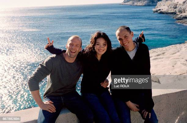 British actor Jason Statham Taiwanese actress Shu Qi and French director Louis Leterrier on the set of the film The Transportor codirected by...