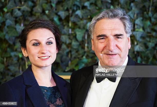 British actor Jim Carter and his daughter Bessie Carter pose on the red carpet as they attend the 61st London Evening Standard Theatre Awards 2015 in...