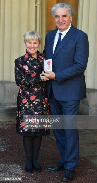 British actor Jim Carter poses with his wife Imelda Staunton after being appointed Officer of the Order of the British Empire at an investiture...