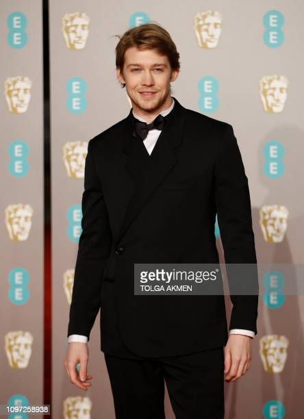 British actor Joe Alwyn poses on the red carpet upon arrival at the BAFTA British Academy Film Awards at the Royal Albert Hall in London on February...