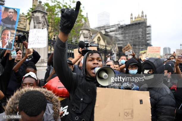 TOPSHOT British actor John Boyega speaks to protestors in Parliament square during an antiracism demonstration in London on June 3 after George Floyd...