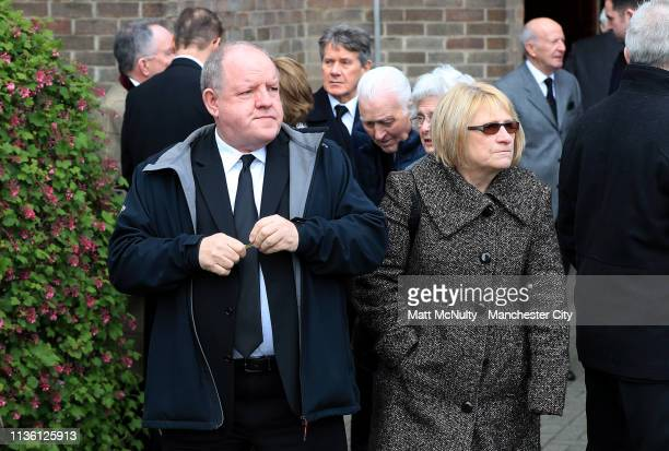 British Actor John Henshaw and partner leave the service at the Funeral of Manchester City Life President Bernard Halford at St Mary's Church in...