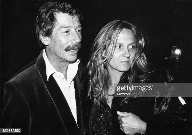 British actor John Hurt arrives at the Royal Albert Hall in London with his wife Donna to attend the musical 'The Hunting of the Snark' based on...
