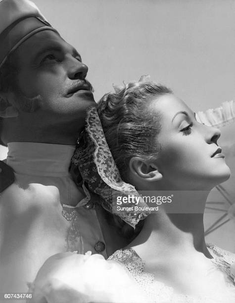 British actor John Loder and French actress Danielle Darrieux on the set of Katia based on the novel by Princesse Bibesco and directed by Maurice...
