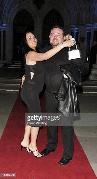 British actor John Thompson and his wife leave the party for the premiere of Johnny English at the Royal Courts of Justice in London on April 6 2003