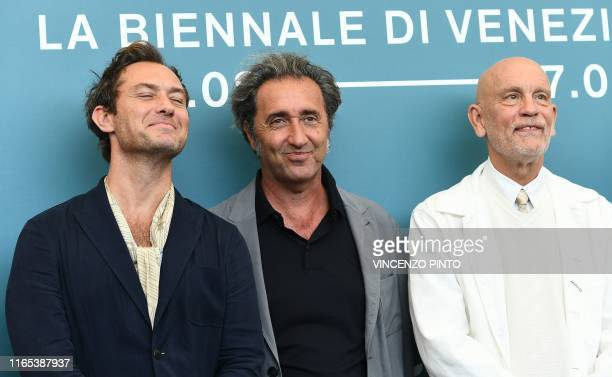 TOPSHOT British actor Jude Law Italian director Paolo Sorrentino and US actor John Malkovich attend a photocall for the upcoming television series...
