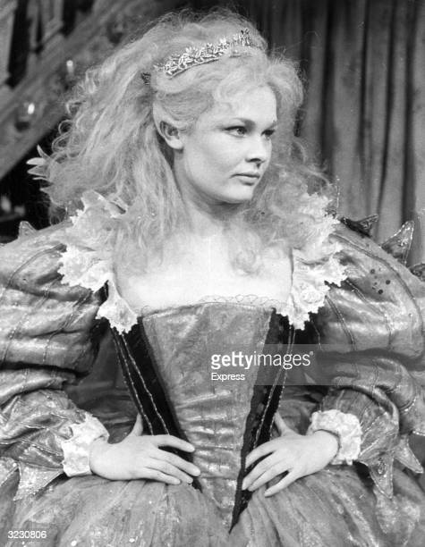 British actor Judi Dench stands with her hands on her hips in costume as Titania for a stage production of William Shakespeare's play 'A Midsummer...