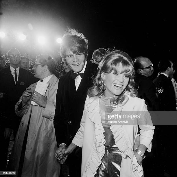 British actor Julie Christie and her date Don Bessant arrive at the Academy Awards Santa Monica California April 18 1966 Christie won Best Actress...