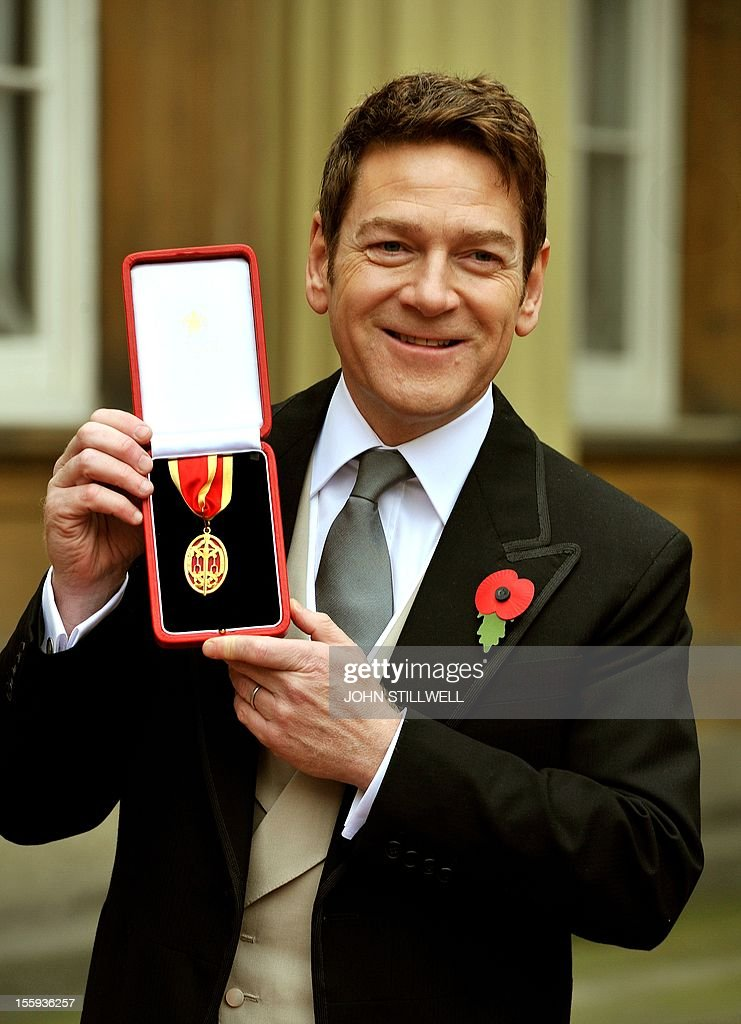 British actor Kenneth Branagh poses with his award after receiving a knighthood from Queen Elizabeth II at an investiture ceremony at Buckingham Palace in London on November 9, 2012. AFP PHOTO/POOL/John Stillwell