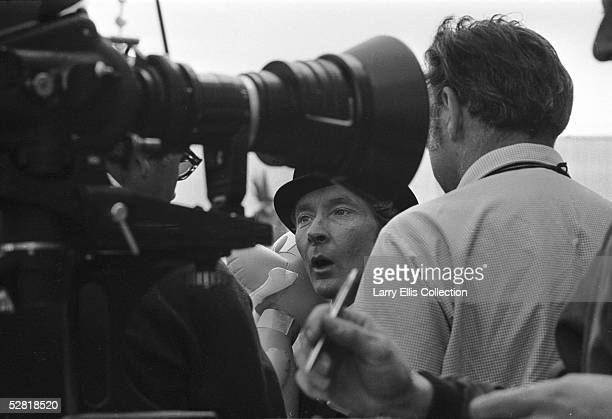 British actor Kenneth Williams talking to the crew during the filming of 'Carry On At Your Convenience' 1971