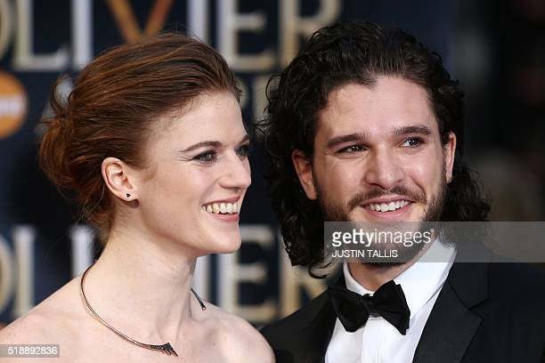British actor Kit Harington and British actress Rose Leslie pose on the red carpet upon arrival to attend the 2016 Laurence Olivier Awards in London...
