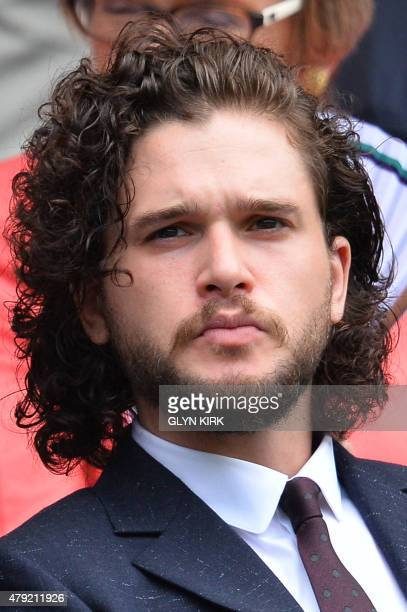 British actor Kit Harington sits in the Royal Box on Centre Court to watch US player Christina McHale play against Germany's Sabine Lisicki during...
