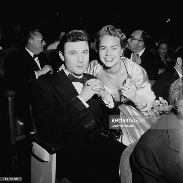 British actor Laurence Harvey and American actress Terry Moore attend the premiere of British film 'Moulin Rouge' US December 1952