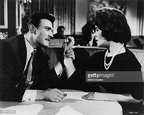 British actor Laurence Harvey grasps the wrist of Britishborn actress Elizabeth Taylor in a scene from the MGM film 'Butterfield 8' 1960