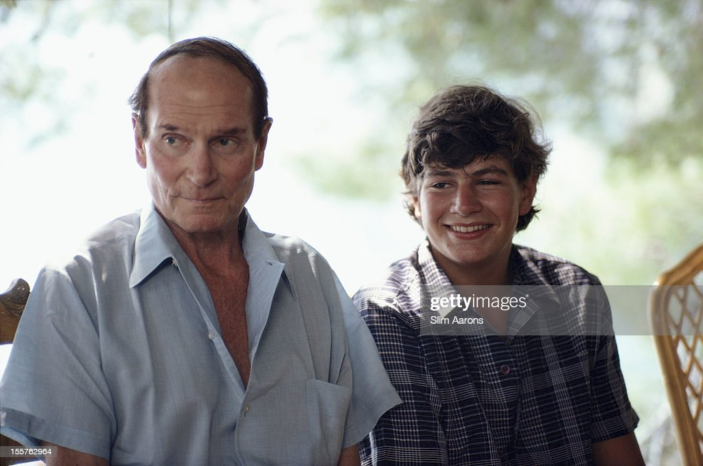 British actor Laurence Olivier (1907-1989) and his son, Richard, at the villa belonging to Franco Zeffirelli in Positano, Italy, in August 1979.
