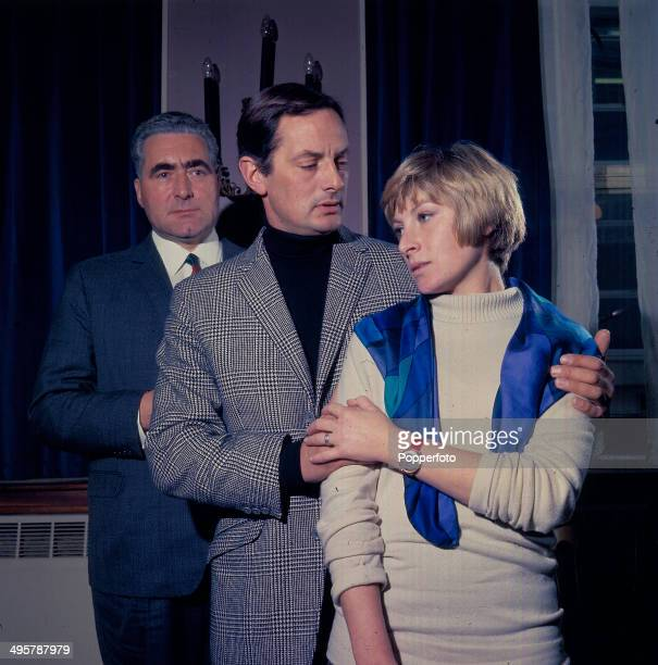 British actor Leslie Sands stands behind fellow actor Francis Matthews and actress Ann Lynn in a scene from the television drama series 'The...