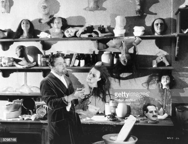 British actor Lionel Atwill surveys his collection of wax heads in 'The Mystery Of The Wax Museum' directed by Michael Curtiz for Warner Brothers
