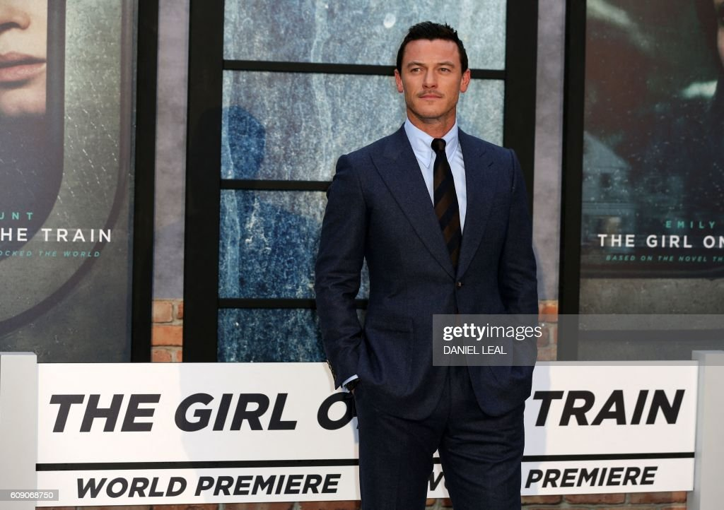 British actor Luke Evans poses for photographers as he arrives to attend the World Premiere of the film 'The Girl on the Train', in central London on September 20, 2016. / AFP / DANIEL