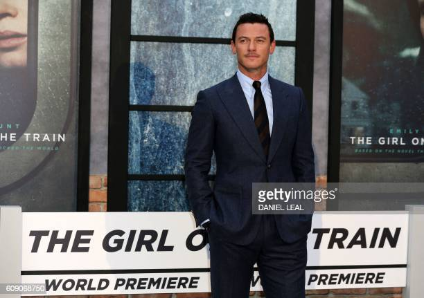 British actor Luke Evans poses for photographers as he arrives to attend the World Premiere of the film 'The Girl on the Train' in central London on...
