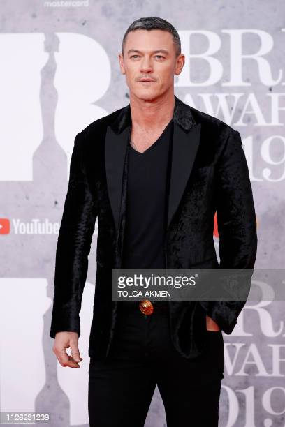 British actor Luke Evans poses on the red carpet on arrival for the BRIT Awards 2019 in London on February 20 2019 / RESTRICTED TO EDITORIAL USE NO...