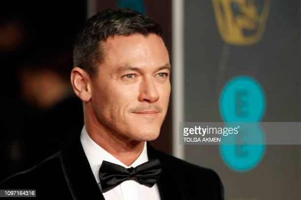 British actor Luke Evans poses on the red carpet upon arrival at the BAFTA British Academy Film Awards at the Royal Albert Hall in London on February...