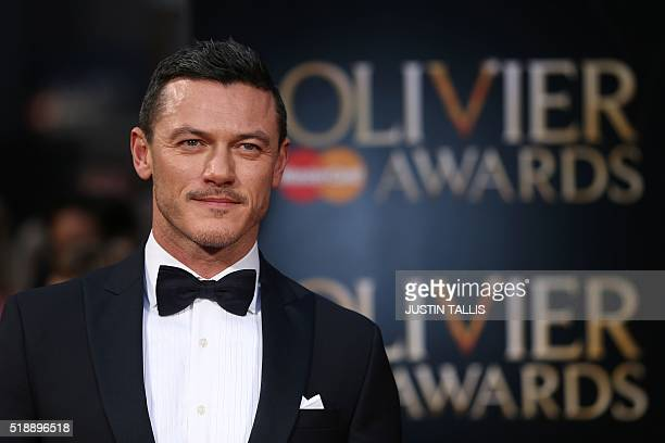 British actor Luke Evans poses on the red carpet upon arrival to attend the 2016 Laurence Olivier Awards in London on April 3 2016 / AFP / JUSTIN...