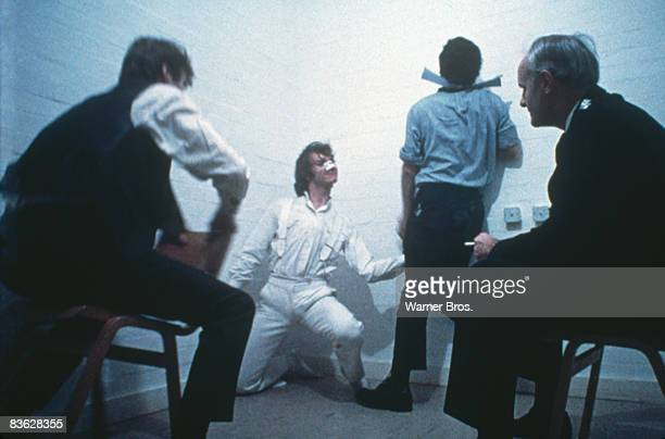 British actor Malcolm McDowell antagonises the police in a scene from 'A Clockwork Orange' 1971