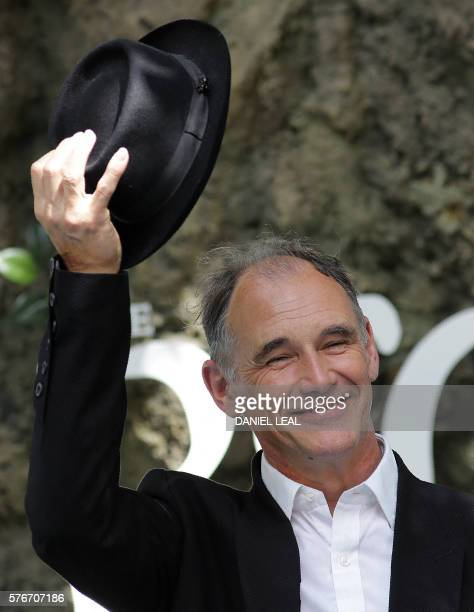British actor Mark Rylance tips his hat as he arrives to attend the UK premeiere of the film The BFG in Leicester Square central London on July 17...