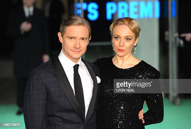 British actor Martin Freeman poses with his partner Amanda Abbington as they arrive at the European premiere of the first in the new trilogy of films...