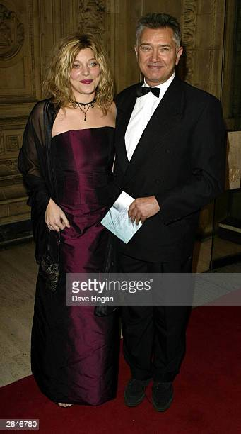 British actor Martin Shaw and wife arrive at the National TV Awards party at the Royal Albert Hall on October 15 2002 in London