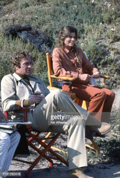 "British actor Michael Caine and American actress Katherine Ross sit on the film set of disaster movie "" The Swarm, directed by Irwin Allen in..."