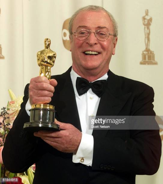 "British actor Michael Caine hold his Oscar for Best Supporting Actor for his role in ""The Cider House Rules"" at the 72nd Annual Academy Awards in Los..."